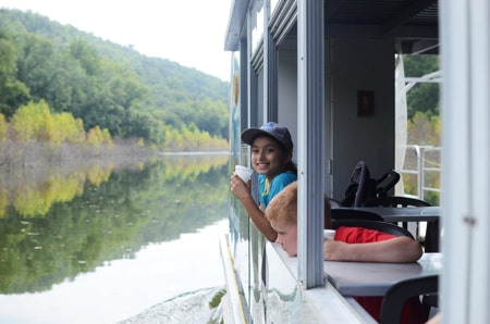 Girl looking out the window of the Cumberland Star Riverboat