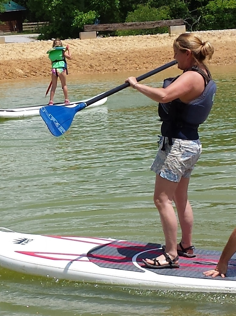Woman on stand up paddle board (SUP)