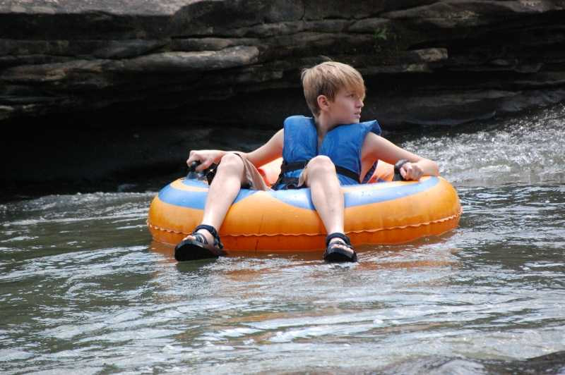 Boy Tubing in Cumberland River