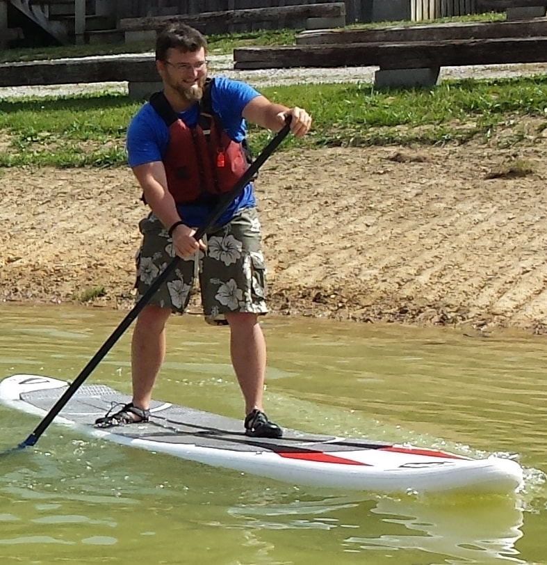 Man on Stand Up Paddle board (SUP)